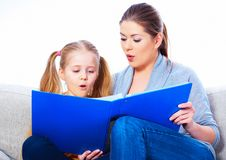 Education at home with parents. Reading book Royalty Free Stock Images