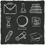 Education icons set on old black board Royalty Free Stock Photos