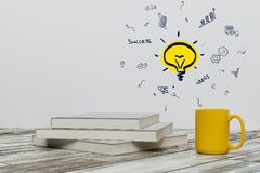 Education and idea concept. Close up of books, coffee cup and creative business sketch. Education and idea concept. 3D Rendering Royalty Free Stock Images