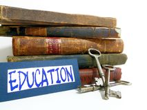Education is key. A stack of books and antique skeleton keys with the word Education Royalty Free Stock Photography