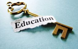 Education key. Closeup of a key and paper note with Education text Royalty Free Stock Photo