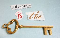 Education Key. Education Is The Key paper notes with gold key Royalty Free Stock Photography