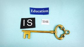 Education key. Education Is The Key text with antique key Royalty Free Stock Image