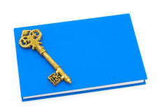 Education is the key to success. Blue book with a golden key isolated on white, Education is the key to success Stock Image