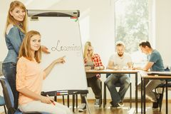 Student girl writting Learning word on whiteboard Royalty Free Stock Images