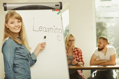 Student girl writting Learning word on whiteboard. Education, knowledge, wisdom and learn new things concept - student girl writing Learning word on whiteboard stock photography