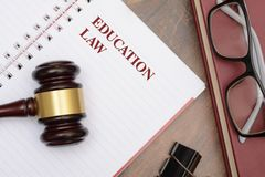 Education Law with gavel and red book.  royalty free stock images