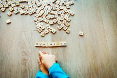 Education and learning - child play with letter puzzle Royalty Free Stock Images