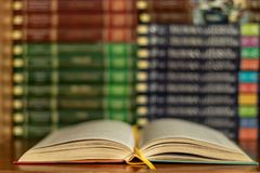 Education learning concept with opening book or textbook in old library stock images