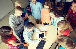 Group of students and teacher at school classroom Stock Images