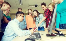 Group of students and teacher at school classroom royalty free stock photography