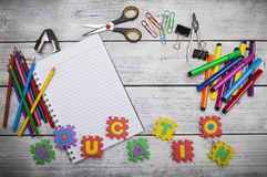 Education letters and office or student gear. Royalty Free Stock Photos