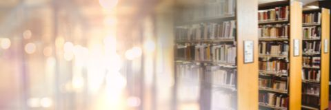 Education library with golden glowing transition. Digital composite of Education library with golden glowing transition royalty free stock photos