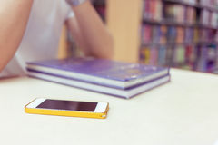 Education lifestyle of young man student using a mobile phone. In library Stock Images