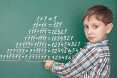Education mathematics concept. With a surprised boy stock photography