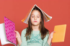 Education through meditation. Young girl meditating with school notebooks Royalty Free Stock Image