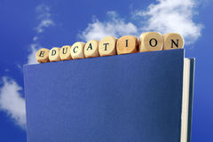 Education message written with wooden blocks on the top of a boo Royalty Free Stock Photo
