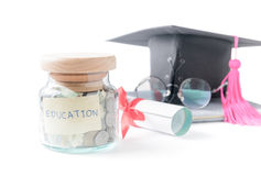 Education money savings in a glass jar Royalty Free Stock Image