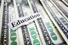 Education news. Closeup of hundred dollar bills and Education news headline Stock Photos