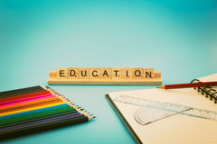 Education notebook and colored pencils royalty free stock image