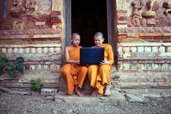 Education of Novice monk Buddhism using laptop learning with fri. Ends sitting in the buddhist church at Nong Khai Thailand royalty free stock photos