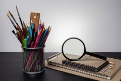 Education objects on black table in dark tone image.  royalty free stock photos
