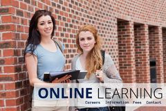 Education and online learning text and women standing Royalty Free Stock Photography