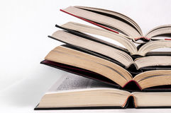 Education and Open books. Open hard bound books stash on top of each other Stock Image
