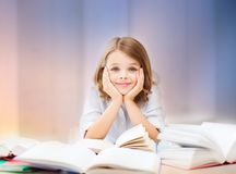 Student girl reading book. Education, people, children and school concept - student girl reading book over rose quartz and serenity gradient background Royalty Free Stock Photography