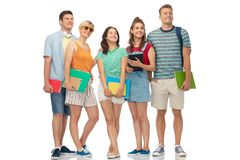 Students with notebooks, books and folders Stock Photo