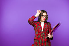 Education and people concept - smiling female student in eyeglasses with bag and notebooks. Tests time Royalty Free Stock Photography