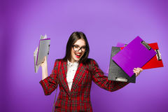 Education and people concept - smiling female student in eyeglasses with bag and notebooks. Tests time Royalty Free Stock Image