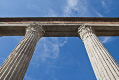 Education pillars. Suggestive shot of roman columns with gorgeous blue sky on the background, San Lorenzo in Milan Royalty Free Stock Photo