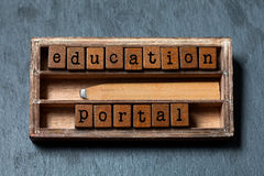 Education portal conceptual image. Vintage blocks with text, retro style pencil in wooden box. Gray stone background Stock Photos