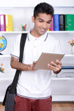 Education. Portrait of a young student of India against the backdrop of the class room royalty free stock image