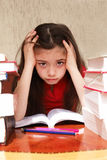 Education problems. Girl hopelessly struggles with homeworks stock photography