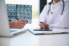 Education profession people and medicine concept close up of hap. Py doctors with tablet and papers at seminar or hospital stock image