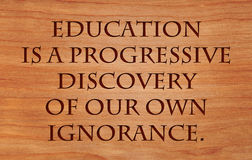 Education is a progressive discovery. Of our own ignorance - quote by Will Durant on wooden red oak background Royalty Free Stock Images