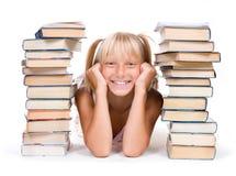 Education.Pupil con los libros Foto de archivo