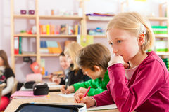 Education - Pupils at school doing homework Royalty Free Stock Images