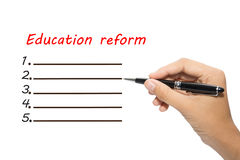 Education reform. Text 'Education reform' in red letters above a blank menu style list of 5 lines with a pen in hand ready to complete the form, white background Stock Images