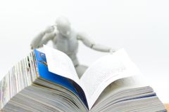 Education: Robot model reading book. Image use for new technology to learn, education concept.  Royalty Free Stock Photo