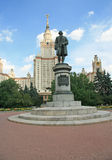 Education in Russia. Monument to Mikhail Lomonosov, main building of Moscow State University royalty free stock photo