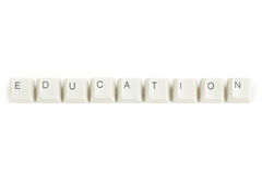 Education from scattered keyboard keys on white. Education text from scattered keyboard keys isolated on white background stock photography