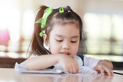 Education and school concept asian (japan, chinese, korea) pretty girl hold a book and reading. Stock Image