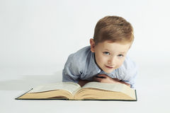 Education and school concept.little student boy with book. On the floor Royalty Free Stock Photography