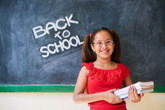 Education School And Happy Girl Smiling Holding Books In Class Royalty Free Stock Image