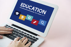 Education School Icon Boxes Concept. Closeup Human Hands Using Laptop Education School Icon Boxes royalty free stock image