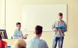 Student boy with notebook and teacher at school Stock Photo