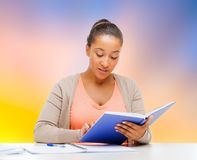 African american student girl reading textbook stock photography